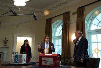 Gallagher Photo - United States President Donald J Trump right listens to Dave Gallagher Associate Director NASA Jet Propulsion Laboratory during a presentation on NASAs COVID-19 response in the Cabinet Room of the White House in Washington DC on April 24th 2020Credit Anna Moneymaker  Pool via CNPAdMedia