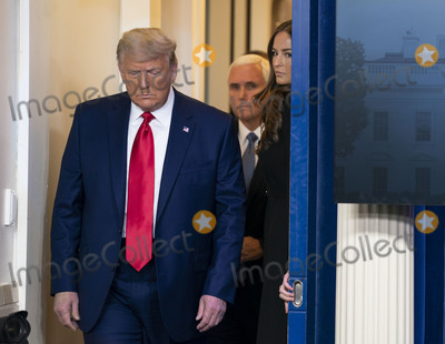Mark Andes Photo - United States President Donald J Trump followed by US Vice President Mike Pence walks to the podium to deliver brief remarks on the stock marked and the Dow reaching 30000 for the first time in history at the White House in Washington DC on Tuesday November 24 2020 Credit Kevin Dietsch  Pool via CNPAdMedia