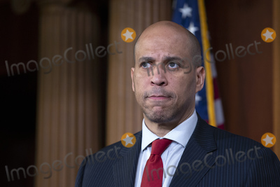 Booker Photo - United States Senator Cory Booker (Democrat of New Jersey) listens during a news conference at the United States Capitol in Washington DC US on Thursday March 12 2020  Booker along with United States Senator Kirsten Gillibrand (Democrat of New York) and United States Senator Kamala Harris (Democrat of California) is working on legislation that would ensure paid sick leave to deal with the Coronavirus  Credit Stefani Reynolds  CNPAdMedia