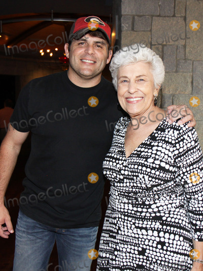Nancy Denson Photo - August 16 2011 - Athens GA - Rhett Akins with Athens GA Mayor Nancy Denson Country artist Colt Ford rounded up his songwriter and artist friends to hold a benefit for the family of Elmer Buddy Christian an Athens Police Officer who died in the line of duty  Prior to the show Colt and friends met fans at a VIP party  Photo credit Dan HarrAdMedia