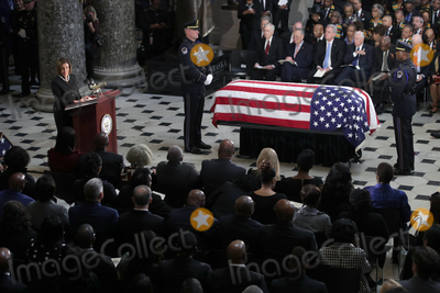 Alex Wong Photo - Speaker of the United States House of Representatives Nancy Pelosi (Democrat of California) gives remarks next to the flag-draped casket of US Representative Elijah Cummings (Democrat of Maryland) as the late congressman lies in state during a memorial service at the Statuary Hall of the US Capitol October 24 2019 in Washington DC Rep Cummings passed away on October 17 2019 at the age of 68 from complications concerning longstanding health challenges Credit Alex Wong  Pool via CNPAdMedia
