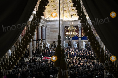 Elijah Cummings Photo - The American flag-draped casket of United States Representative Elijah Cummings (Democrat of Maryland) sits during a memorial service in National Statuary Hall at the US Capitol in Washington DC US on Thursday Oct 24 2019 Cummings a key figure in Democrats impeachment inquiry and a fierce critic of US President Donald J Trump died at the age of 68 on October 17 due to complications concerning long-standing health challenges Credit Al Drago  Pool via CNPAdMedia