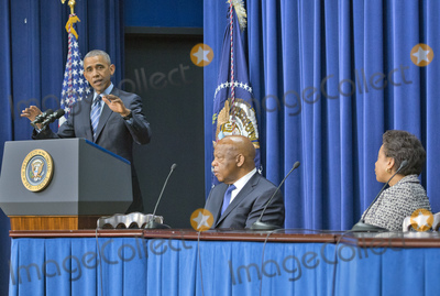 Barack Obama Photo - United States President Barack Obama makes remarks at a session hosted by the White House Office of Public Engagement on strengthening and protecting the right to vote at the White House in Washington DC on Thursday August 6 2015 The event was attended by civil rights leaders faith leaders voting rights activists and state and local officials  From left to right President Obama US Representative John Lewis (Democrat of Georgia) and US Attorney General Loretta LynchCredit Ron Sachs  Pool via CNPAdMedia