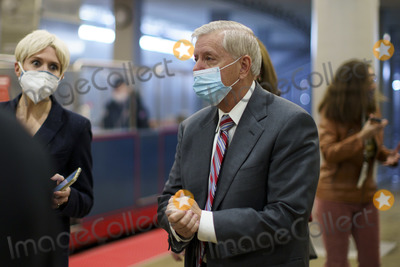 Lindsey Graham Photo - Senator Lindsey Graham a Republican from South Carolina wears a protective mask while walking through the Senate Subway at the US Capitol in Washington DC US on Thursday Feb 11 2021 House prosecutors used the second day of Donald Trumps impeachment trial to detail a months-long campaign by the former president to stoke hatred and encourage violence over the election results that they said culminated in the mob attack on the US Capitol that he then did little to stop Credit Ting Shen - Pool via CNPAdMedia