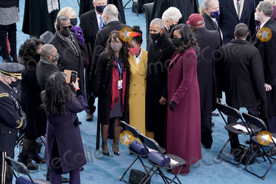 Amanda Gorman Photo - Amanda Gorman center takes a photo with former president Barack Obama and Michelle Obama prior to the 59th Presidential Inauguration on Wednesday January 20 2021 at the US Capitol in Washington DCAdMedia