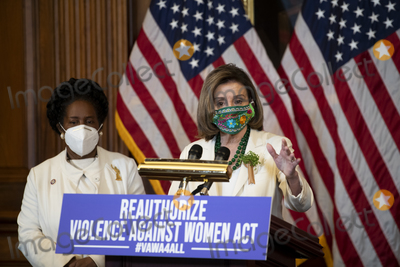 Nancy Pelosi Photo - United States Representative Sheila Jackson-Lee (Democrat of Texas) left listens while Speaker of the United States House of Representatives Nancy Pelosi (Democrat of California) offers remarks at a press conference regarding the Violence Against Women Act at the US Capitol in Washington DC Wednesday March 17 2021 Credit Rod Lamkey  CNPAdMedia