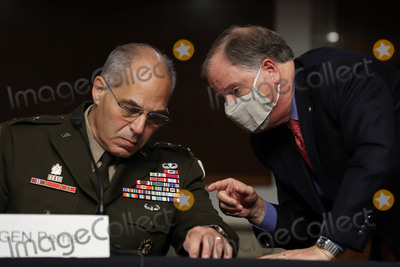 Doug Jones Photo - United States Senator Doug Jones (Democrat of Alabama) (R) talks with US Army General Gustave Perna during his confirmation hearing to co-lead Operation Warp Speed an effort to find a vaccine for COVID-19 before the US Senate Armed Services Committee in the Dirksen Senate Office Building on Capitol Hill June 18 2020 in Washington DC As the commander of Army Materiel Command Perna will be the chief operating officer of the governments effort to find a safe and effective vaccine for the novel coronavirus Credit Chip Somodevilla  Pool via CNPAdMedia
