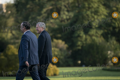 Donald Trump Photo - White House Chief of Staff Mark Meadows right and Dan Scavino Assistant to the President and Deputy Chief of Staff for Communications walk along the South Lawn to join President Donald Trump on Marine One as they depart the White House for a rally in Pennsylvania on Tuesday September 22 2020 in Washington DC      Credit Sarah Silbiger  Pool via CNPAdMedia