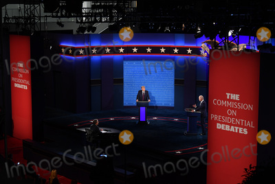 Presidential Campaign Photo - United States President Donald J Trump (C) and Democratic presidential nominee former United States Vice President Joe Biden (R) with Chris Wallace moderating face off in the first of three scheduled 90 minute presidential debates in Cleveland Ohio on Tuesday September 29 2020Credit Kevin Dietsch  Pool via CNPAdMedia