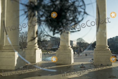 Vandals Photo - A view through the broken windows of the front entrance doors of the US Capitol in the aftermath the morning after a riot by pro-Trump supporters who stormed and vandalized the US Capitol as Electoral votes were being counted during a joint session of the United States Congress to certify the results of the 2020 presidential election Washington DC Thursday January 7 2021 Credit Rod Lamkey  CNPAdMedia