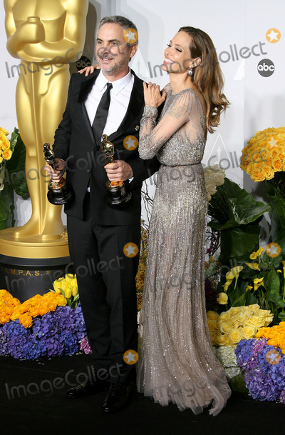 Alfronso Cuaron Photo - 02 March 2014 - Hollywood California - Alfronso Cuaron Angelina Jolie 86th Annual Academy Awards held at the Dolby Theatre at Hollywood  Highland Center Photo Credit AdMedia