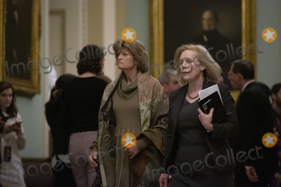 Alaska  Photo - United States Senator Lisa Murkowski (Republican of Alaska) and United States Senator Kirsten Gillibrand (Democrat of New York) make their way to the Senate Chamber following a dinner break during the second day of opening statements in the impeachment trial of United States President Donald J Trump at the United States Capitol in Washington DC US on Wednesday January 22 2020Credit Stefani Reynolds  CNPAdMedia