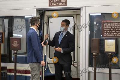 Train Photo - United States Senator Todd Young (Republican of Indiana) talks with a reporter as he boards a train in the Senate subway following a Senate procedural vote to advance the nomination of Alejandro Mayorkas as secretary of homeland security at the US Capitol in Washington DC Thursday January 28 2021 Credit Rod Lamkey  CNPAdMedia