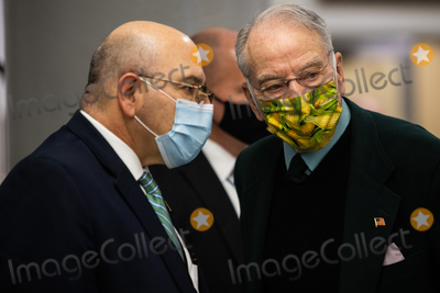 Chuck Grassley Photo - Senator Chuck Grassley R-IA speaks with an unidentified person on Capitol Hill in Washington Saturday Feb 13 2021 before the fifth day of the second impeachment trial of former President Donald TrumpCredit Graeme Jennings - Pool via CNPAdMedia