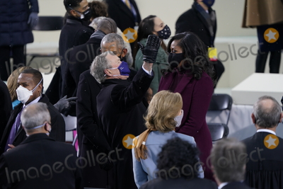 Michelle Obama Photo - Former United States President George W Bush greets former first lady Michelle Obama prior to Joe Biden taking the Oath of Office as the 46th President of the US at the US Capitol in Washington DC on Wednesday January 20 2021  Credit Chris Kleponis  CNPAdMedia