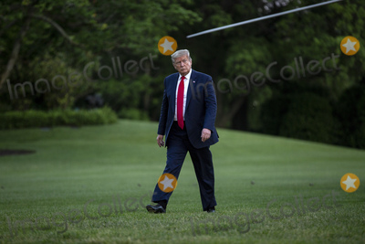 White House Photo - United States President Donald J Trump walks on the South Lawn of the White House in Washington DC US as he arrives from the Kennedy Space Center in Florida on Saturday May 30 2020  Trump vowed his administration would end what he called mob violence in US cities following the death of an unarmed black man at the hands of Minnesota police blaming leftist groups for clashes with police and property damage around the nation Credit Stefani Reynolds  Pool via CNPAdMedia