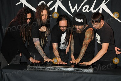 Jonathan Davis Photo - 8 October 2013 - Hollywood California - James Shaffer Munky Brian Welch Head Jonathan Davis Reginald Arvizu Fieldy Ray Luzier Korn Korn Inducted Into Guitar Centers RockWalk held at Guitar Center Hollywood Photo Credit Byron PurvisAdMedia