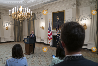 The Vaccines Photo - United States President Joe Biden takes questions after delivering remarks on the Covid-19 response and the vaccination program from the State Dining Room of the White House in Washington DC on Tuesday May 4 2021  The President announced he will allow some governors to turn down doses they dont need or want and reallocate those doses to other states and he also set a goal of getting at least one dose of the Covid-19 vaccine to 70 percent of adults by July 4Credit Alex Edelman  Pool via CNPAdMedia