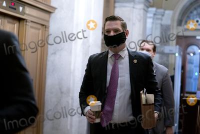 Donald Trump Photo - Representative Eric Swalwell a Democrat from California wears a protective mask while arriving to the US Capitol in Washington DC US on Saturday Feb 13 2021 The Senate approved 55-45 a request to consider calling witnesses in the second impeachment trial of Donald Trump a move that may extend the trial that was expected to end within hoursCredit Stefani Reynolds - Pool via CNPAdMedia