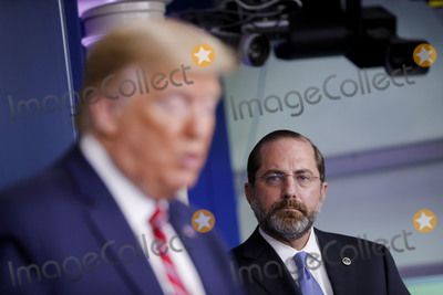 Alex Azar Photo - United States Secretary of Health and Human Services (HHS) Alex Azar listens as US President Donald J Trump left speaks during a Coronavirus Task Force news conference in the briefing room of the White House in Washington DC US on Friday March 20 2020 Americans will have to practice social distancing for at least several more weeks to mitigate US cases of Covid-19 Director of the National Institute of Allergy and Infectious Diseases at the National Institutes of Health Dr Anthony Fauci said today Credit Al Drago  Pool via CNPAdMedia
