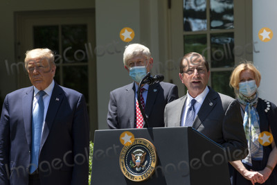 Alex Azar Photo - United States President Donald J Trump listens as United States Secretary of Health and Human Services (HHS) Alex Azar delivers remarks regarding Coronavirus vaccine developments in the Rose Garden of the White House in Washington DC US on Friday May 15 2020  Credit Stefani Reynolds  CNPAdMedia