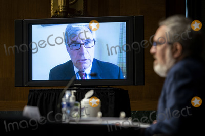 Andrew Wheeler Photo - United States Senator Sheldon Whitehouse (Democrat of Rhode Island) speaks virtually during a US Senate Environment and Public Works Committee hearing with Andrew Wheeler administrator of the Environmental Protection Agency (EPA) on Capitol Hill in Washington DC US on Wednesday May 20 2020 Credit Al Drago  Pool via CNPAdMedia