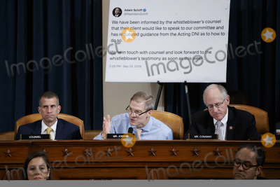 Alexander Vindman Photo - United States Representative Jim Jordan (Republican of Ohio) questions Special Advisor for Europe and Russia in the office of US Vice President Mike Pence Jennifer Williams and Director for European Affairs of the National Security Council US Army Lieutenant Colonel Alexander Vindman during the House Permanent Select Committee on Intelligence public hearing on the impeachment inquiry into US President Donald J Trump on Capitol Hill in Washington DC USA 19 November 2019 The impeachment inquiry is being led by three congressional committees and was launched following a whistleblowers complaint that alleges US President Donald J Trump requested help from the President of Ukraine to investigate a political rival Joe Biden and his son Hunter BidenCredit Shawn Thew  Pool via CNPAdMedia