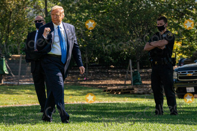 White House Photo - United States President Donald J Trump walks to Marine One on the South Lawn of the White House on Thursday October 15 2020 Trump will deliver remarks at a Fundraising Committee Reception in Doral Floridaand participate in a Live NBC News Town Hall Event    Credit Ken Cedeno  Pool via CNP