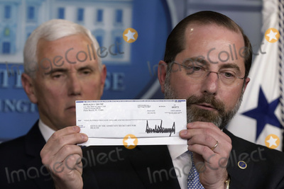 Alex Azar Photo - United States Secretary of Health and Human Services (HHS) Alex Azar holds 100000 Q4 salary check donated to HHS by President Donald Trump to fight coronavirus during a press conference with Vice President Mike Pence and members of the Coronavirus Task Force at the White House in Washington on March 3 2020 Credit Yuri Gripas  Pool via CNPAdMedia