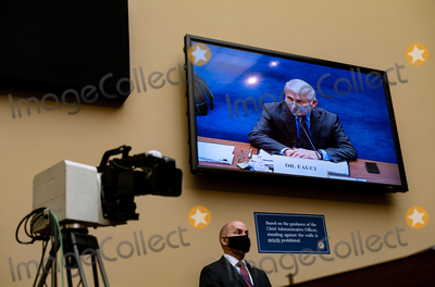 Anthony Fauci Photo - Monitor showing Dr Anthony Fauci Director of the National Institute of Allergy and Infectious Diseases at the National Institutes of Health as he testifies before the US House Select Subcommittee on the Coronavirus Crisis holds a hearing on the Capitol Hill in Washington on Thursday April 15 2021 Credit Amr Alfiky  Pool via CNPAdMedia