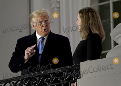 Supremes Photo - United States President Donald J Trump gestures towards Justice Amy Coney Barrett following the ceremony where she took the oath of office to be Associate Justice of the Supreme Court on the Blue Room Balcony of the White House in Washington DC US October 26 2020 Credit Ken Cedeno  Pool via CNPAdMedia