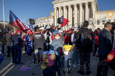 Supremes Photo - A woman in a tin foil hat pushes her carts through the crowd as thousands of supporters of United States President Donald J Trump fill the streets in front of the United States Supreme Court and the grounds of the US Capitol following a pro-Trump MAGA rally and march in Washington DC on Saturday November 14 2020Credit Rod Lamkey  CNPAdMedia
