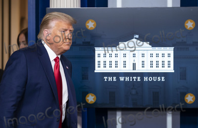 Mark Andes Photo - United States President Donald J Trump walks to the podium to deliver brief remarks on the stock marked and the Dow reaching 30000 for the first time in history at the White House in Washington DC on Tuesday November 24 2020 Credit Kevin Dietsch  Pool via CNPAdMedia
