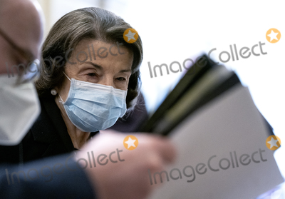 Dianne Feinstein Photo - United States Senator Dianne Feinstein (Democrat of California) right wears a protective mask while walking to the Senate Chamber at the US Capitol in Washington DC US on Tuesday Feb 9 2021 The Senate begins Donald Trumps second impeachment trial today with a fight over whether the proceeding is constitutional as a number of conservative lawyers reject the defense teams claim that a former president cant be convicted of a crime by Congress Credit Stefani Reynolds  Pool via CNPAdMedia