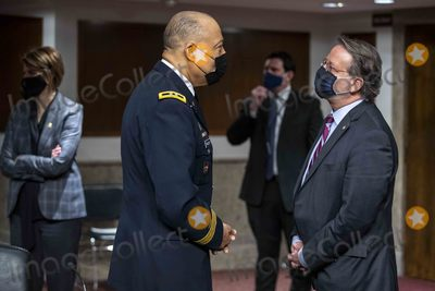 The Used Photo - United States Senator Gary Peters (Democrat of Michigan) Chairman US Senate Committee on Homeland Security and Government Affairs (R) talks with Commanding General District of Columbia National Guard Major GeneralWilliam J Walker (L) prior to the Senate Homeland Security and Governmental AffairsRules and Administration hearing to examine the January 6 2021 attack on the US Capitol on Capitol Hill  in Washington DC USA 03 March 2021Credit Shawn Thew  Pool via CNPAdMedia
