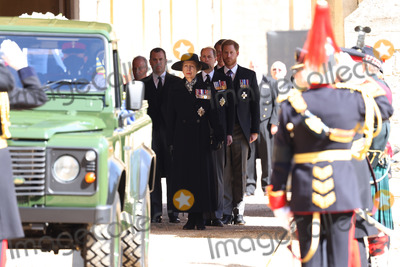 Prince Harry Photo - Photo Must Be Credited Alpha Press 073074 17042021Princess Anne Princess Royal Prince Edward Earl of Wessex Peter Phillips Prince Harry Duke of Sussex Earl of Snowdon David Armstrong-Jones and Vice-Admiral Sir Timothy Laurence follow Prince Philip Duke of Edinburghs coffin on a modified Jaguar Land Rover during the Ceremonial Procession during the funeral of Prince Philip Duke of Edinburgh at St Georges Chapel in Windsor Castle in Windsor Berkshire No UK Rights Until 28 Days from Picture Shot Date AdMedia