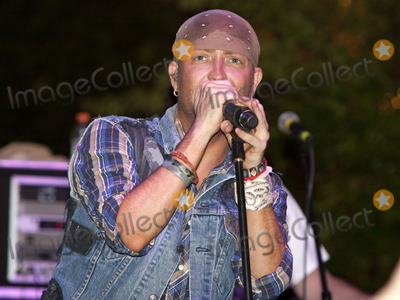 LoCash Cowboys Photo - June 11 2011 - Woodstock GA - Preston Brust The LoCash Cowboys headlined at the Woodstock Summer Concert Series and performed songs from their current album for a large crowd Photo credit Dan HarrAdMedia