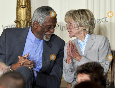 The Ceremonies Photo - Bill Russell left and Jean Kennedy Smith right share a thought during the ceremony where United States President Barack Obama and first lady Michelle Obama honor them and the other recipients of the 2010 Medal of Freedom the Nations highest civilian honor presented to individuals who have made especially meritorious contributions to the security or national interests of the United States to world peace or to cultural or other significant public or private endeavors in a ceremony in the East Room of the White House in Washington DC on Tuesday February 15 2011Credit Ron Sachs  CNPAdMedia