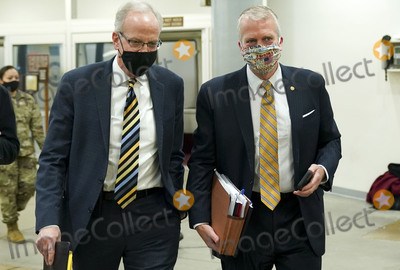 Jerry Moran Photo - Sen Jerry Moran R-Kans and Sen Dan Sullivan R-Alas walk through the Capitol Subway at the US Capitol in Washington DC on Friday February 12 2021 The legal team for former President Donald Trump begins their presentation of defense today Credit Leigh Vogel  Pool via CNPAdMedia