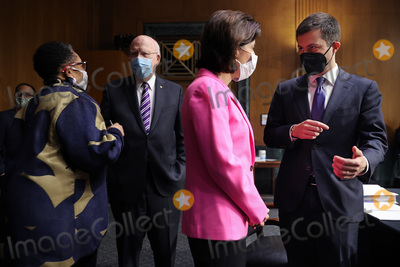 Pete Buttigieg Photo - WASHINGTON DC - APRIL 20 (L-R) United States Secretary of Housing and Urban Development Marcia Fudge US Senator Patrick Leahy (Democrat of Vermont) Chairman US Senate Committee on Appropriations US Secretary of Commerce Gina Raimondo and US Secretary of Transportation Pete Buttigieg talk before a committee hearing in the Dirksen Senate Office Building on Capitol Hill on April 20 2021 in Washington DC Members of President Bidens cabinet are testifying about the American Jobs Plan the administrations 23 trillion infrastructure plan that has yet to win over a single Republican in Congress Credit Chip Somodevilla   Pool via CNP