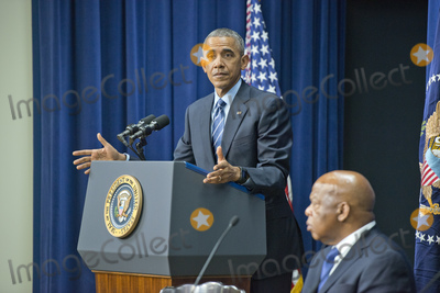 Barack Obama Photo - United States President Barack Obama makes remarks at a session hosted by the White House Office of Public Engagement on strengthening and protecting the right to vote at the White House in Washington DC on Thursday August 6 2015 The event was attended by civil rights leaders faith leaders voting rights activists and state and local officials  At right is US Representative John Lewis (Democrat of Georgia)Credit Ron Sachs  Pool via CNPAdMedia