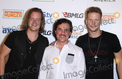 Brian Kelley Photo - 05 April 2013 - Las Vegas NV -  Florida Georgia Line Tyler Hubbard and Brian Kelley Scott Borchetta  2013 ACM Experience and Big Machine Label Groups  Outnumber Hunger Red Carpet at the Orleans Arena Photo Credit mjtAdMedia