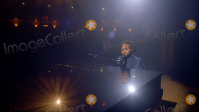 John Legend Photo - In this image from the Democratic National Convention video feed American singer-songwriter John Legend performs on the last night of the convention on Thursday August 20 2020Credit Democratic National Convention via CNPAdMedia