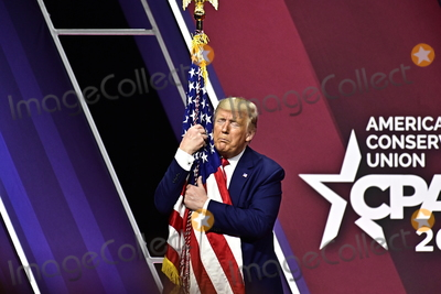 American Flag Photo - United States President Donald J Trump embraces the American Flag after speaking at the Conservative Political Action Conference (CPAC) at the Gaylord National Resort and Convention Center in National Harbor Maryland on Saturday February 29 2020Credit Ron Sachs  CNPAdMedia