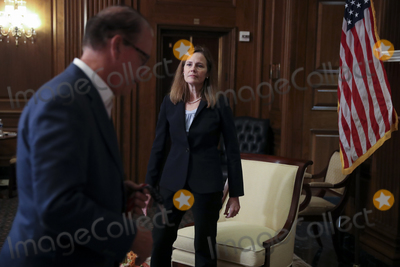 Seal Photo - Amy Coney Barrett US President Donald Trumps nominee for associate justice of the US Supreme Court right meets with United States Senator Mike Braun (Republican of Indiana) center a Republican from Indiana at the US Capitol in Washington DC US on Wednesday Sept 30 2020 A bruising Senate confirmation fight over Trumps Supreme Court choice may seal the fates of several incumbent senators in the November election though it has yet to drastically alter the odds for which party will control the chamber Credit Oliver Contreras  Pool via CNPAdMedia