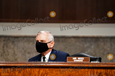 The Unit Photo - United States Senator Jack Reed (Democrat of Rhode Island) Chairman US Senate Committee on Armed Services listens before a hearing on the United States Special Operations Command and United States Cyber Command with the Senate Armed Services Committee on Capitol Hill in Washington DC on March 25th 2021Credit Anna Moneymaker  Pool via CNPAdMedia