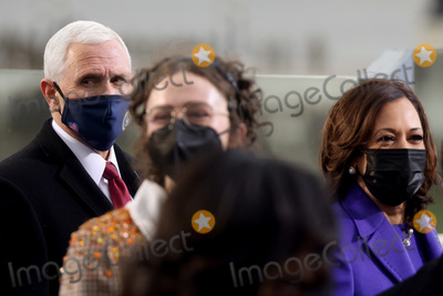 Mike Pence Photo - US Vice President Mike Pence and Vice President-elect Kamala Harris attend the inauguration of Biden as the 46th President of the United States on the West Front of the US Capitol in Washington US January 20 2021 REUTERSJonathan ErnstPoolAdMedia