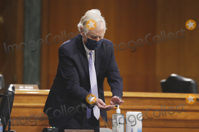 Angus King Photo - United States Senator Angus King Jr (Independent of Maine) uses hand sanitizer during a US Senate Intelligence Committee nomination hearing for US Representative John Ratcliffe (Republican of Texas) on Capitol Hill in Washington Tuesday May 5 2020 The panel is considering Ratcliffes nomination for director of national intelligence Credit Andrew Harnik  Pool via CNPAdMedia