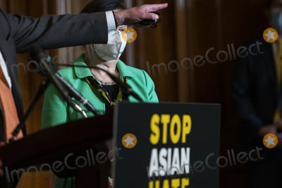 The Used Photo - United States Senator Mazie Hirono (Democrat of Hawaii) right listens as United States Senate Majority Leader Chuck Schumer (Democrat of New York) offers remarks during a press conference following Senate passage of the COVID-19 Hate Crimes Act at the US Capitol in Washington DC Thursday April 22 2021 Credit Rod Lamkey  CNPAdMedia