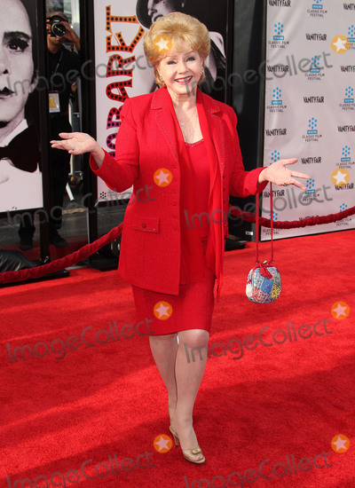 Graumans Chinese Theatre Photo - 28 December 2016 - Debbie Reynolds the Oscar-nominated Singin in the Rain  singer-actress who was the mother of late actress Carrie Fisher has died She was 84 She wanted to be with Carrie her son Todd Fisher told Variety She was taken to the hospital from Todd Fishers Beverly Hills house Wednesday after a suspected stroke the day after her daughter Carrie Fisher died File Photo 12 April 2012 - Hollywood California - Debbie Reynolds 2012 TCM Classic Film Festival Opening Night Gala Held at Graumans Chinese Theatre Photo Credit Russ ElliotAdMedia
